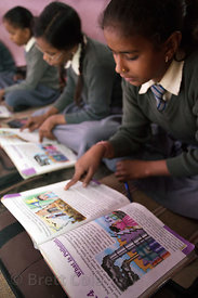 Girls read a lesson on environmental issues at a school in Varanasi, India operated by the Dutch NGO Duniya (duniya.org)