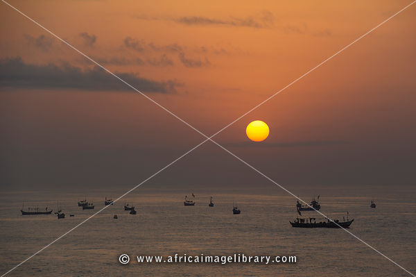 Fishing pirogues at sunrise, Biriwa, Ghana