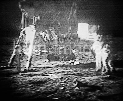 20 July 1969-  Neil A. Armstrong, commander; and Edwin E. Aldrin Jr., lunar module pilot, commemorate their historical landin...