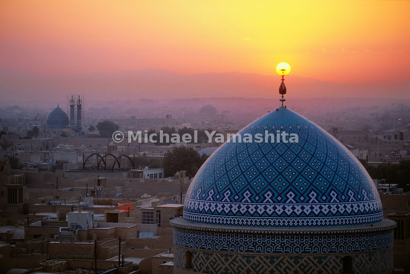 Sunset illuminates the 12th century Jame (Friday) Mosque, known for its striking blue Persian tile work.  Yzad, Iran
