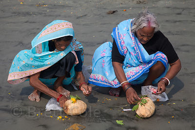 Pilgrims bathe and pray in the Bay of Bengal at the Gangasagar Mela (festival), a pilgrimage to Sagar Island in India, where ...