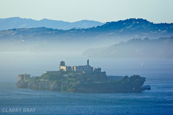 Alcatraz in soft blue mist in the bay in San Francisco, USA
