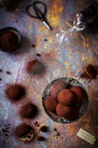 Little buttery, crumbly, eggless cookies, dusted with cocoa powder that look like small chocolate truffles.