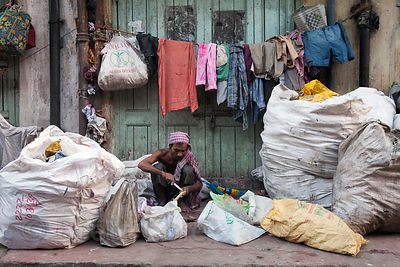 A man maintains a meager independent recycling operation in Kumartoli, Kolkata, India.