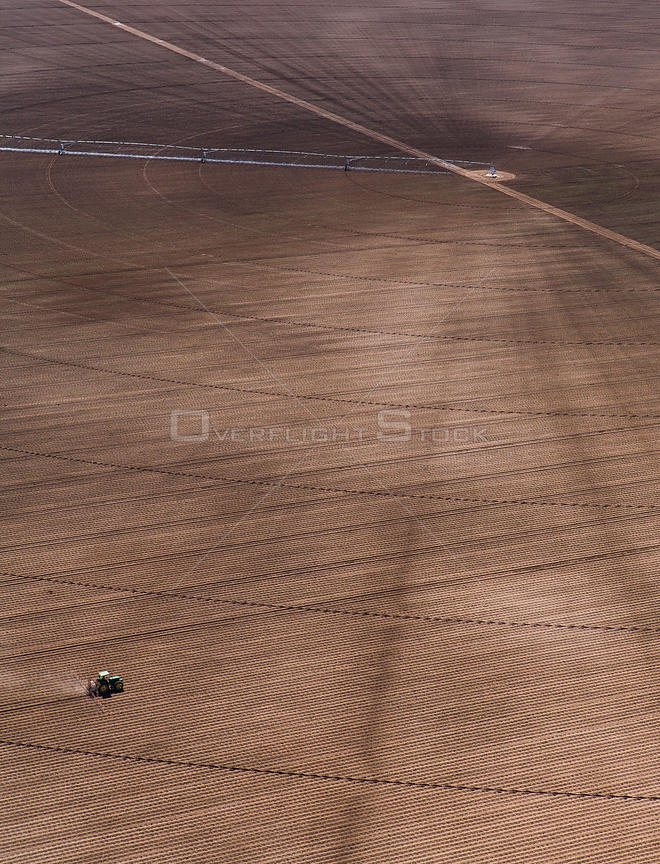 Vast field with rotary irrigation and tractor, Chihuahua, Mexico. May 2008.