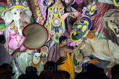 A large, ornate, beautiful Durga Puja idol in a pandal in Gariahat, Kolkata, India.