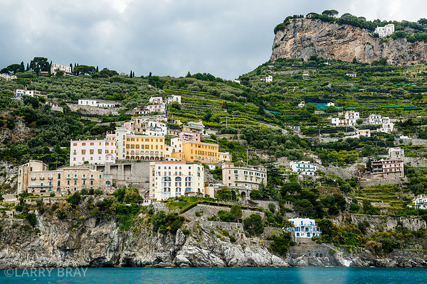 View of houses built on tiers on hillside of Amalfi coast in Italy