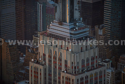 People on top of the Empire State Building at dusk