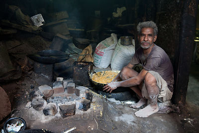 A man mixes an unknown food product in a shop in Jodhpur, Rajasthan, India