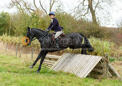 Sophie Judge jumping a hunt jump near Peake's. The Cottesmore Hunt at Somerby