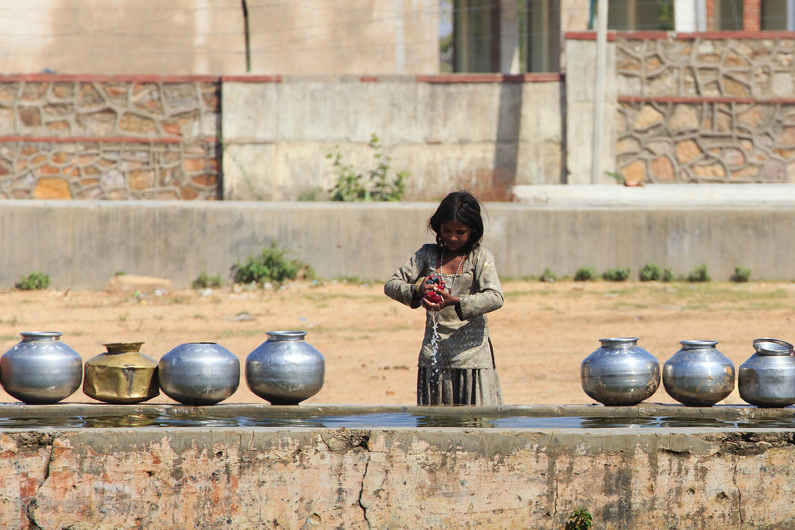 A girl does laundry at a trough, Ganaheda village, Rajasthan, India