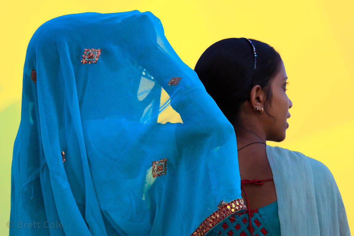Women in colorful saris watch hot air balloons, Pushkar, Rajasthan, India