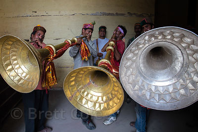Men blow large metal horns during the celebration of Dussehra in Kullu, India