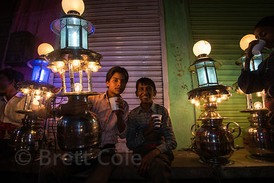 Boys are paid 6 cents per hour to carry these lights in marriage processions, Badi Basti, Pushkar, Rajasthan, India