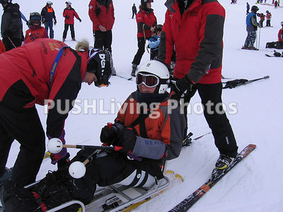 Young woman using a snow sit ski