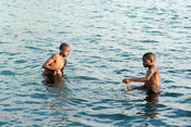 Boys fishing with a net, lake Niassa, Mozambique