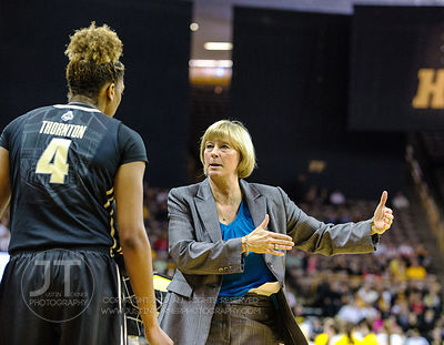 Purdue's Sharon Versyp instructs Torrie Thornton (4) during a timeout versus Iowa during the first half of play at Carver-Haw...