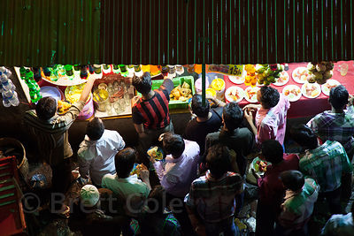 Overhead view of a crowd at a market stall in Bandra East, Mumbai, India.