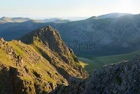 Sunrise over Ennerdale from Scoat Fell with views of Steeple In the English Lake District, UK.