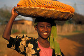 Girl carrying a basket on her head, Ambo, Ethiopia