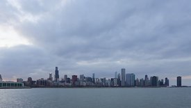 Wide Shot: Chicago Skyline Flares Up At Sunset