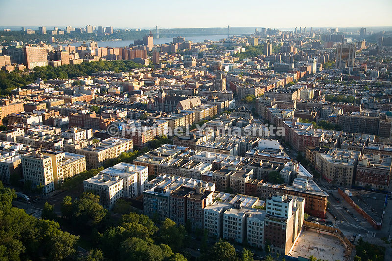 The northwest neighborhoods of Manhattan include parks, row houses, wide thoroughfares and views of the Hudson River.