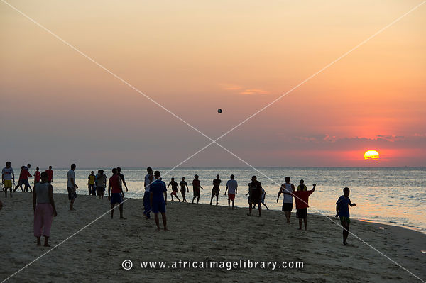 Soccer game on the beach at sunset, Zanzibar, Tanzania