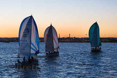 Sailboats at sunset near the Inner Harbor, Baltimore, Maryland