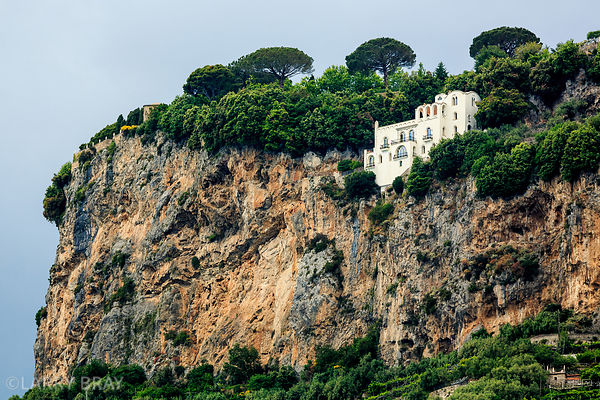 a large house precariously built on a cliff face on Amalfi coast, Itlay