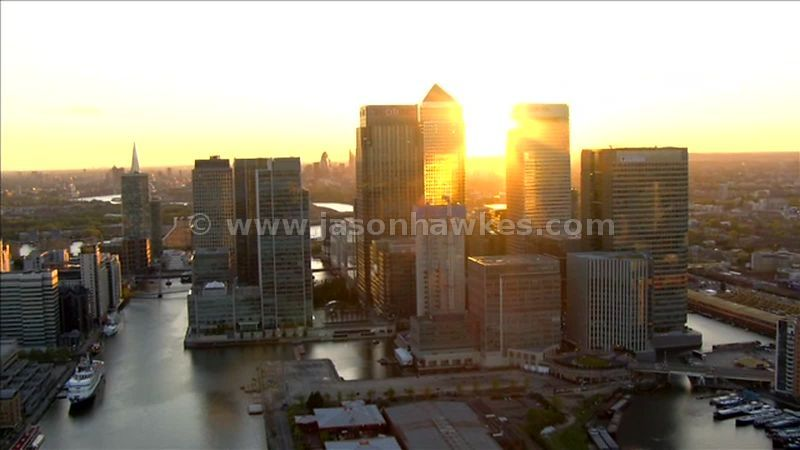 Aerial footage around Canary Wharf office buildings at sunset, London, England, UK