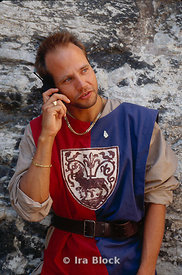 Man in medieval costume with cell phone