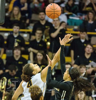 Iowa's Chase Coley (4) defends Purdue's Ashley Morrissette (1) during the second half of play at Carver-Hawkeye Arena in Iowa...