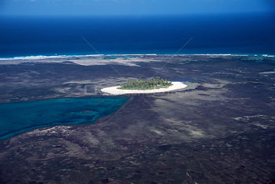 Aerial view of Alphonse island, coral atoll and lagoon (ex volcanic crater), Seychelles, Indian Ocean