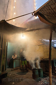 Smoke pours from a shop in Lake Gardens, Kolkata, India. Air pollution in Kolkata is critically poor.