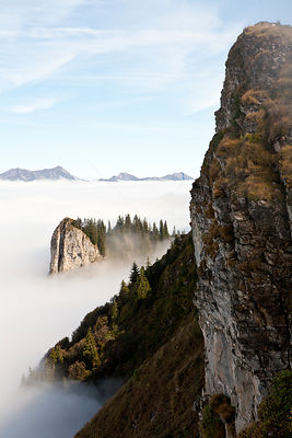 View east from near Oberberghorn (2069m) along a steep escarpment rising out of a sea of clouds, Bernese Oberland alpine regi...