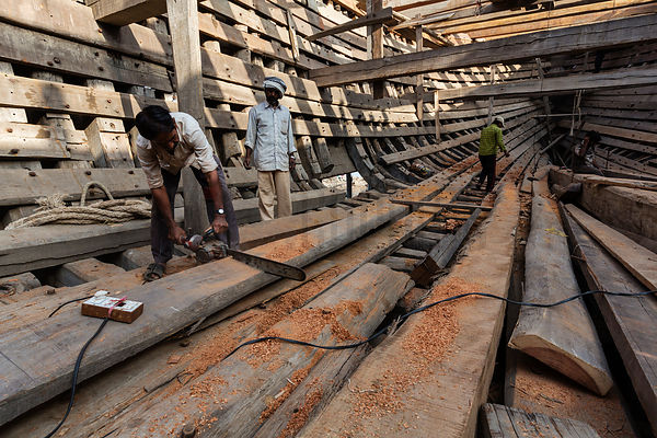 Ship Builders at Constructing Wooden Cargo Vessels at Mandvi