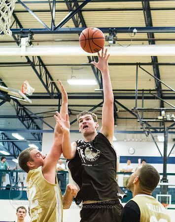 Iowa's Adam Woodbury floats a shot over Southeastern CC's Nick Lyon during Primetime League play at the North Liberty Recreat...