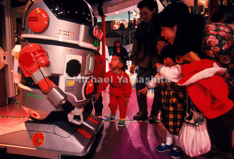 A Japanese family meet a robot at Space World in Kitakyushu City, Japan.