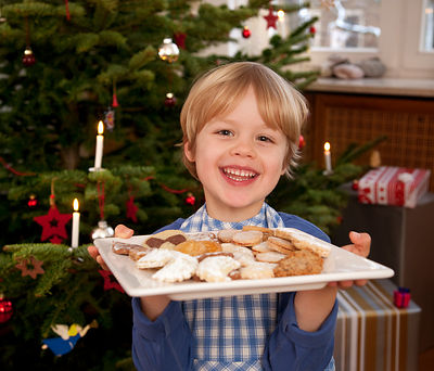 boy holding plate of homemade biscuits