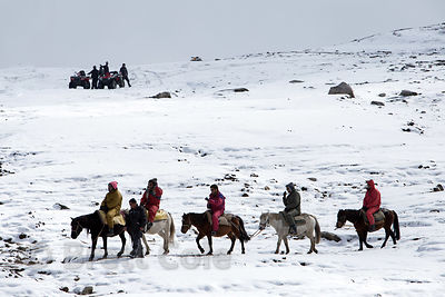 Indian tourists ride horses at Snow Point on the summit of Rohtang Pass, Manali, India