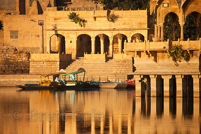 Morning sun and reflections in Gadi Sagar, Jaisalmer, Rajasthan, India