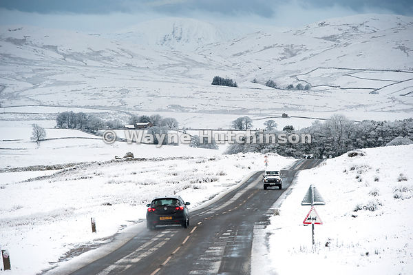 Traffic on the A683 between Kirkby Stephen and Sedbergh, Cumbria, in snowy weather conditions.