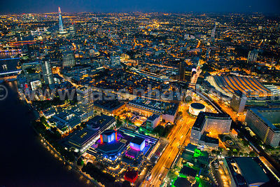 Aerial view over Southbank and River Thames at night, London
