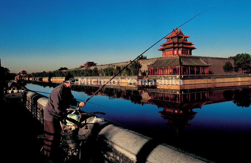 In springtime, fishermen line the bank of the moat that surrounds the Forbidden City.