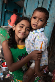 Portrait of a girl and her brother near Newmarket, Kolkata, India.