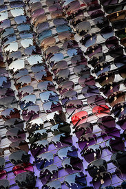 Shoppers are reflected in sunglasses at a market in Connaught Circle, Delhi, India