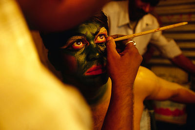 A actor is prepared for a religious play in a suburb of Delhi