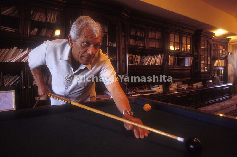 Saddam's Poet Laureat, Abdul Rassaq Wahid playing pool in his house in Baghdad.