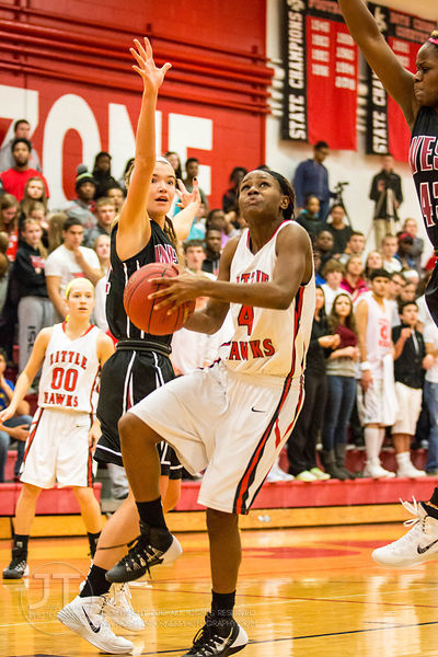 Iowa City High's Kiera Washpun (4) goes up for a layup versus Waterloo West during the first half of play at the Iowa City Hi...