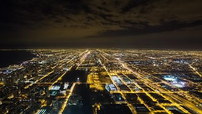 Bird's Eye: Extra Wide View of Chicago's Urban Light Grids Lighting a Bed of Stratocumulus at Night